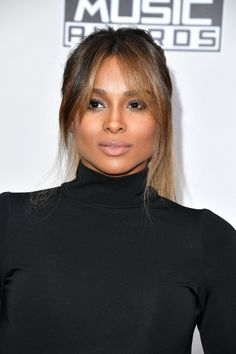 Ciara literally glowed on the American Music Awards 2016 red carpet in Los Angeles.