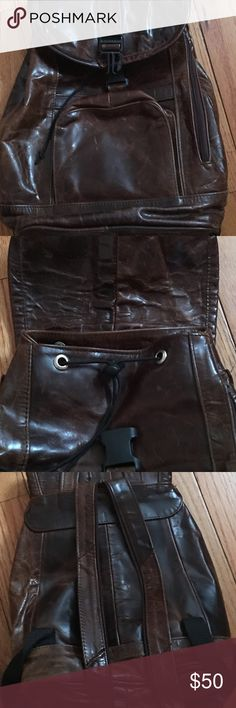 Mexican Distressed Chocolate Leather Backpack Distress chocolate leather backpack. Made in Mexico of genuine leather. ** the buckle is broken on the front but the way I have kept my belongings safe is is by the Drawstring that sets in place so nothing goes in or out (second pic). The backpack strap is a zip up so it can be a backpack or sling. It's got major space in the inside, small pocket in the front and a small side zip compartment as well. Any questions please ask 😊 Vintage Bags…