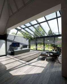 Conservatory extension and roof Modern extension with wooden floor. , : Conservatory extension and roof Modern extension with wooden floor. Modern Conservatory, Conservatory Extension, House Extension Design, Glass Extension, Glass Room, House Extensions, Glass House, Interior And Exterior, My House