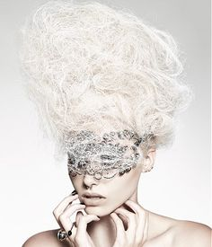 A long blonde straight wavy white colored updo sculptured avant-garde hairstyle by Hooker & Young