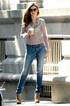 Miranda Kerr,Rocking a Chiffon sequin Shirt and Skinny Leg Jeans simple yet effective.