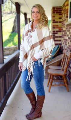 Shop Now! Camel Bold Plaid Poncho Cape.  The perfect accessory for cool days. Warm, soft, and comfortable.