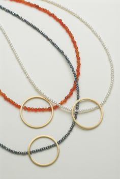 Bead necklaces with geometric gold shapes in 18 carat gold (also available in silver) by Daphne Krinos