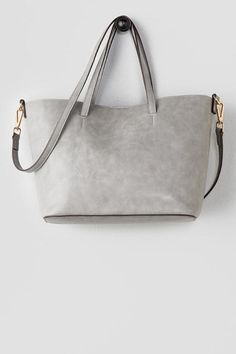 """The Verbena Distressed Tote is the perfect carry-all tote! The smooth faux leather of this bag has a distressed look to it, making it feel like its been yours for years! Finished with a magnetic snap closure, additional inside pouch & optional crossbody strap.<br /> <br /> - 16"""" length x 9.5"""" height<br /> - 7"""" strap drop<br /> - 26"""" optional shoulder strap drop<br /> - Imported"""