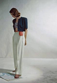 ca. 1946 --- Model in red, white and blue rayon garbadine slack suit with bolero by Arrowhead --- Image by © Condé Nast Archive/CORBIS