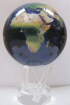 """4.5"""" Satellite View MOVA Globe with Nature Earth by MOVA GLOBE. $154.99. FREE SHIPPING within continental US or US PO box. NO SALE TAX.. No batteries or wires are needed. MOVA Globe rotatesPowered by solar energy and the earth's magnetic field at a perfect point of balance between buoyant forces and gravitational forces. Powered by solar energy and the earth's magnetic field. Absolutely silent operation. This 4.5 Satellite View MOVA Globe with Natural Earth"""