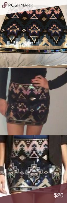 *NWOT* Amazing Express Aztec Sequin Mini Skirt *NWOT* Express Sequin Aztec Mini Skirt in Size Medium. I originally purchased this skirt to wear for NYE and went with another option. It is an amazing skirt to wear with a plain black tank, blazer or bodysuit! Never worn so NWOT- open to offers! Express Skirts Mini