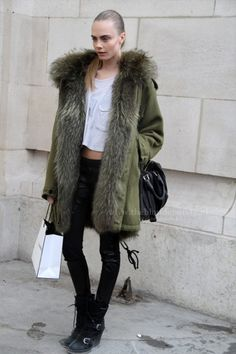 Cara Delevingne mixing up fur and military.