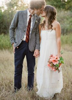 bride and groom. love the groom's attire.
