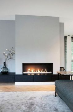 contemporary living room fireplace 1 Source by SandyMarry The post modern living room . - contemporary living room fireplace 1 Source by SandyMarry The post modern living room fireplace 1 a - Linear Fireplace, Home Fireplace, Fireplace Remodel, Living Room With Fireplace, Fireplace Surrounds, Fireplace Design, Fireplace Modern, Fireplace Ideas, Fireplace Inserts