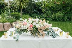 Hartley Botanica Wedding - Sweetheart table centerpiece - floral arrangement - decor - gold candle votives - garden style - loose - greenery - blush - ivory - pink - eucalyptus - PC: HD Studio - Design & Planning by DB Creativity - laura@dbcreativity.com