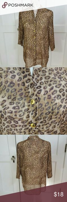 "Susan Graver Top. Tan & brown animal print with gold metallic threads  6 Goldtone buttons. (Extra button) tab collar side Slits. 3/4"" wide sleeves 27 "" long 21"" Arm Pit to Arm Pit lying flat. New never worn. 99 poly 1 metallic. Susan Graver Tops"