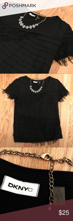 DKNYC Small Black t-shirt with chiffon ruffles DKNYC (Donna Karan NYC) Black t-shirt with chiffon ruffles. Shirt has seen a lot of love and the chiffon ruffles are taking on a new shaggy look. Still very fun and pretty shirt. Necklace shown for styling and not included. DKNYC Tops