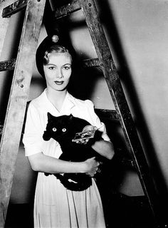 Veronica Lake with black cat