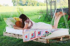 Repurposed Recycled Reused Reclaimed Restored How To Build A Swinging Wood Pallet Bed  http://themerrythought.com/diy/diy-pallet-swing-bed/ Enjoy the sunshine as the seasons change from Summer int