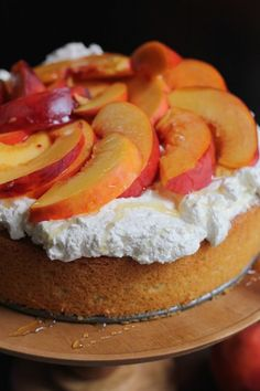 A light and elegant Olive Oil Honey Cake with fresh homemade whipped cream, sliced peaches and lightly drizzled with honey. Dessert doesn't get any better than this. #cake #peaches #yum