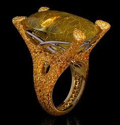 """Mousson Atelier New Age Collection """"""""Sabre"""""""" Gold 750 Rutile Quartz and Sapphire Ring featuring 40.28ct Rutile Quartz and 5.69ct Yellow Sapphire; 25.10g total weight"""