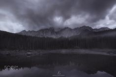 Dark Karersee - An old shot of Lake caress. The conditions were not the best but they have helped to create a dark and gray atmosphere. Hope you like it