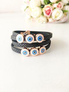 Evil eye bracelet, evil eye beads, leather strand bracelet, elegant bracelet, blue evil eye charm, nazar boncuk, evil eye jewelry, greek eye #jewelry #bracelet #bridalshower #evileye #leather #evileyecharm #evileyebead #evileyebracelet #leatherbracelet #charmbracelet #blueevileye #greekjewelry