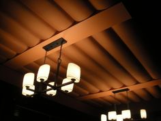 Puffed stretched fabric acoustical ceiling panels