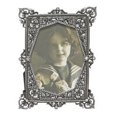 Metal picture frame with scrolling jeweled detail.   Product: Picture frameConstruction Material: Metal and glass...