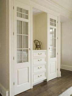 GREAT closet door idea... in my office I could order doors with NO glass and then use fabric or buliten boards etc! Likey!!!!!