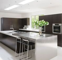 Minimalist Beverly Hills Home - The sleek kitchen, composed of oak and stainless steel, represents a collaboration between Magni and Haefele Design. The barstools are by Mark Albrecht Studio, and the ovens are by Miele. Küchen Design, Deco Design, Home Design, Interior Design, Design Ideas, Nail Design, Modern Design, Architectural Digest, New Kitchen