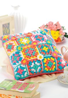 Spring shades granny square crochet cushion