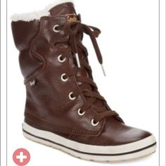 NEW Brown keds sneaker boots Brown leather upper Keds sneaker boots and rubber soles. Comes with brown and white laces. 6. 1/2 inch shaft height and faux shearling lining along inside ankle keds Shoes Sneakers