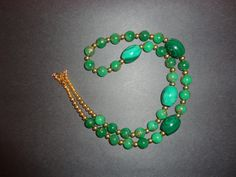 Stunning antique green jade with gold overlay are stranded with 4 beautiful malachite beads.  26 inches and a certain statement piece !! - pinned by pin4etsy.com