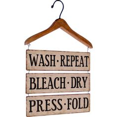 Add a rustic touch to your laundry room with this eye-catching wall decor, showcasing a typographic design and weathered beige finish.