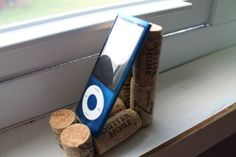 Wine cork phone stand. Saw this on etsy!! I have plenty of corks to do this myself!!!