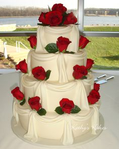 Red roses on a white cake - beautiful