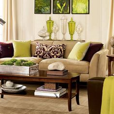"great example of neutral furnishings, floor, & walls, with the ""pops"" of color/contrast in accessories so easy to change out for different seasons Brown & Green Living Room"