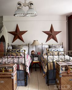 Fashion Editor Kim Hersov's Sons' Room An industrial table and a '60s French stool in the boys' room; the stars are flea-market finds, and the trunks are from Hubert Zandberg Interiors.