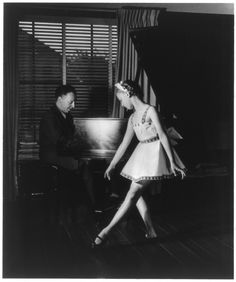 Artur Rubinstein, 1886    Full length, seated at piano, facing right; with his daughter Eva in ballet costume.