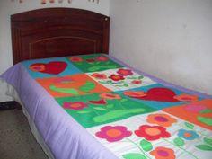 Tendido de cama elaborado en patchwork