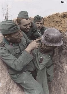 Sniper hit on a dummy trooper helmet.... This was oftenly done in coaction with enemy snipers. The opposing sniper would shoot the dummy & by doing so, give away his position. Creating an opportunity for a counter sniper to locate him & take him out!!