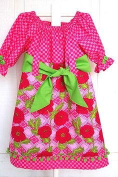 """I used """"Claire"""" by Portabellopixie to make this dress and added the the sash and hem band.Fabrics are both Michael Miller prints."""