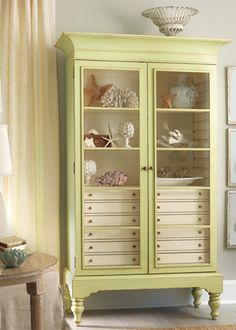 Love this storage piece. The color, the glass doors,  etc would go great in our master bath once we no longer have a dog with their crate taking up that space.