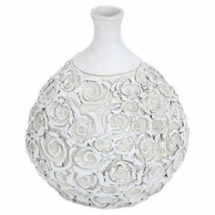 """Ceramic vase with embossed rosettes and a narrow neck.  Product: VaseConstruction Material: CeramicColor: WhiteFeatures:  Made of high quality materialsElegant designSuits modern and convential décor  Dimensions: 12"""" H x 11"""" Diameter"""