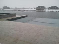 Closing the auto cover on this infinity edge pool done by All Seasons Pools and Spas out of Orland Park, IL