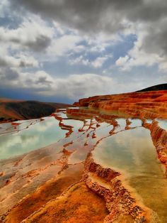 Sari, Iran. Badab-e Surt; It comprises a range of stepped travertine terrace formations that has been created over thousands of years as flowing water from two mineral hot springs cooled and deposited carbonate minerals on the mountain side. http://irantravelpackages.com
