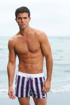 Mens Swim Shorts - Sauvage. Show off your patriotic spirit with the subtly of red, white and blue stripes. Wholesome yet hot, this easy-to-wear masculine design is perfected in universally appealing colors. It also flaunts a retro fit that's come back into style. #mensswimshorts