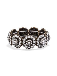 Try wearing this stunning oversized crystal-encrusted bracelet on its own, or create a statement stack with other crystal cuffs.
