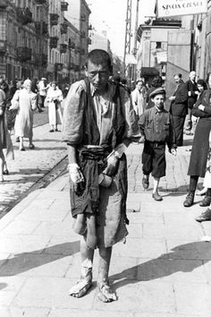 Warsaw, Poland, A starving child in a ghetto street, 1941. One of the photographs taken by the German photographer Willi George over the course of a single day in the summer of 1941. The photographs are unique in that they were not staged, but showed the ghetto as it truly was.