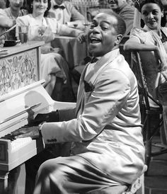 "Dooley Wilson in Casablanca (1942) as Sam. Sam was a piano player/singer at the bar ""Rick's"""