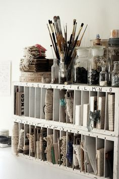 Organization in sewing room - old bingo cards for trim storage and paper rack. Old jars for button storage