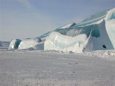Off Mackinaw City, in a particularly cold winter, the water in Lake Huron below the surface ice supercooled. It expanded to break through the surface ice and froze into this incredible wave
