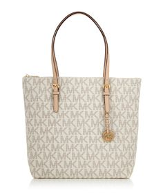 Ivory leather perforated MK tote bag by Michael Kors on secretsales.com